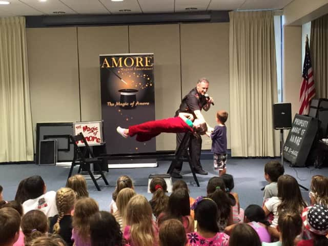 Magician Amore performed as the grand finale for 2016 Summer Reading Game at the Eastchester Library. The library started renovations Aug. 15.