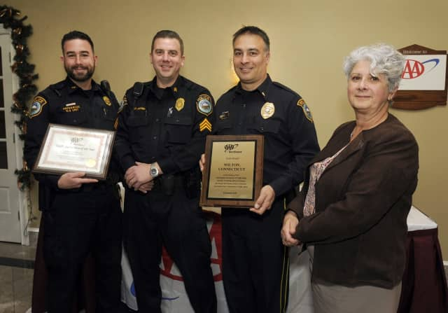 Public Affairs Manager Fran Mayko (right) presents the awards to (from left) Officer Patenude; Sgt. David Hartman, who is a AAA driving improvement instructor; and Lt. Robert Kluk.