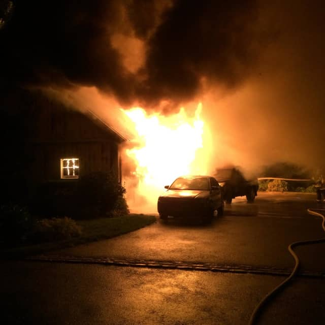 Norwalk fire fighters put out a garage fire Tuesday night.