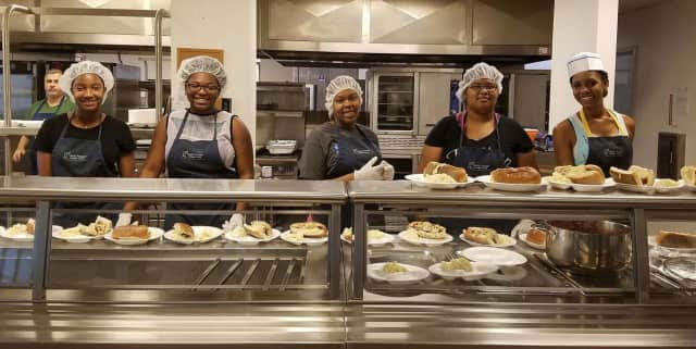 The Teaneck InterAct Club serves up meals for residents of the Bergen County Housing, Health and Human Services Center in Hackensack.