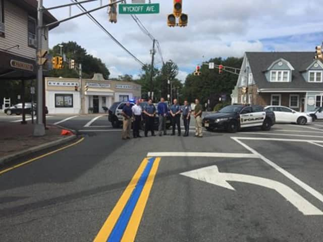 Wyckoff police, officials with thin blue line on Franklin Avenue early Tuesday.