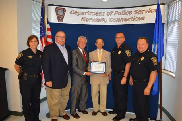 Cesar Ramirez was named Police Service Officer of the Month in Norwalk for his work organizing an interfaith prayer vigil on Aug. 3.