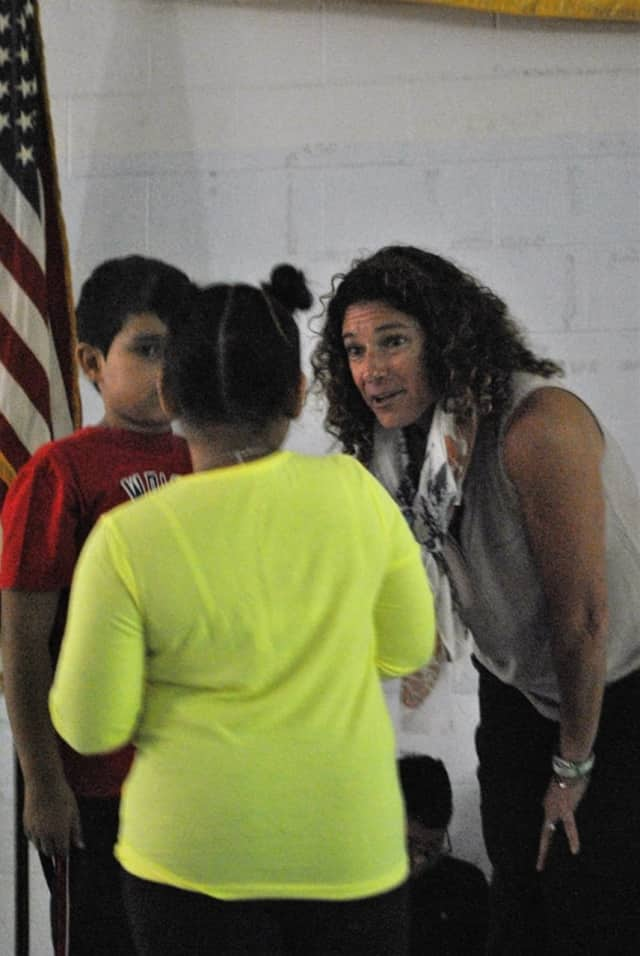 Sandy Hook Promise member Donna Moxham role-plays with Pembroke Elementary students to highlight the Start with Hello program during an assembly on Friday at the Danbury school.