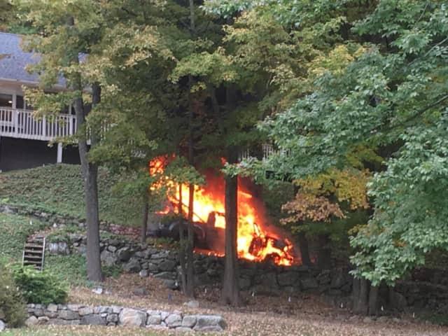 The Ridgefield Volunteer Fire Department responds Saturday to a burning truck on Danbury Road.
