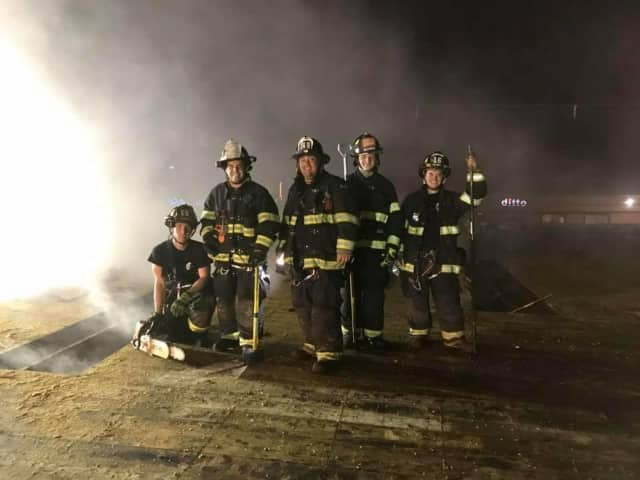 Franklin Lakes volunteer firefighters in action. The department will be holding an open house on Nov. 21 to bolster its membership.