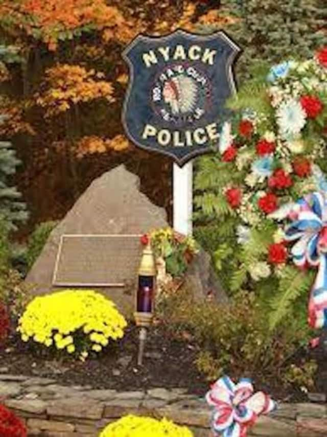 A memorial marks the spot where two Nyack police officers were killed following a Brinks robbery.