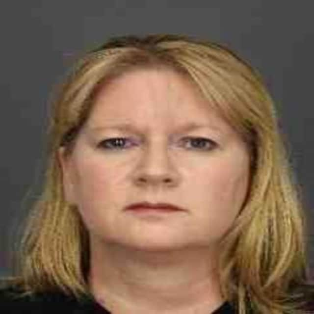 Cheryl Higgins was charged with stealing $500,000 from a White Plains dentist.