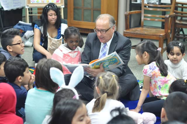 Mayor James Cassella reads to children at East Rutherford Library.