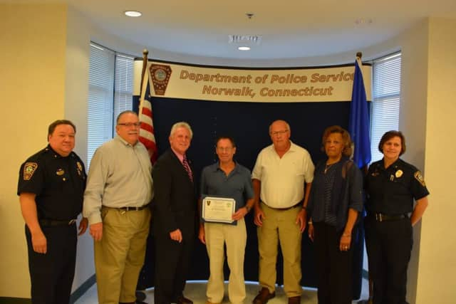 From left, Deputy Chief Ashley Gonzalez, Commissioner Charles Yost, Mayor Harry Rilling, Michael Golden, Edward Brennan, Commissioner Fran Collier-Clemmons and Deputy Chief Susan Zecca.
