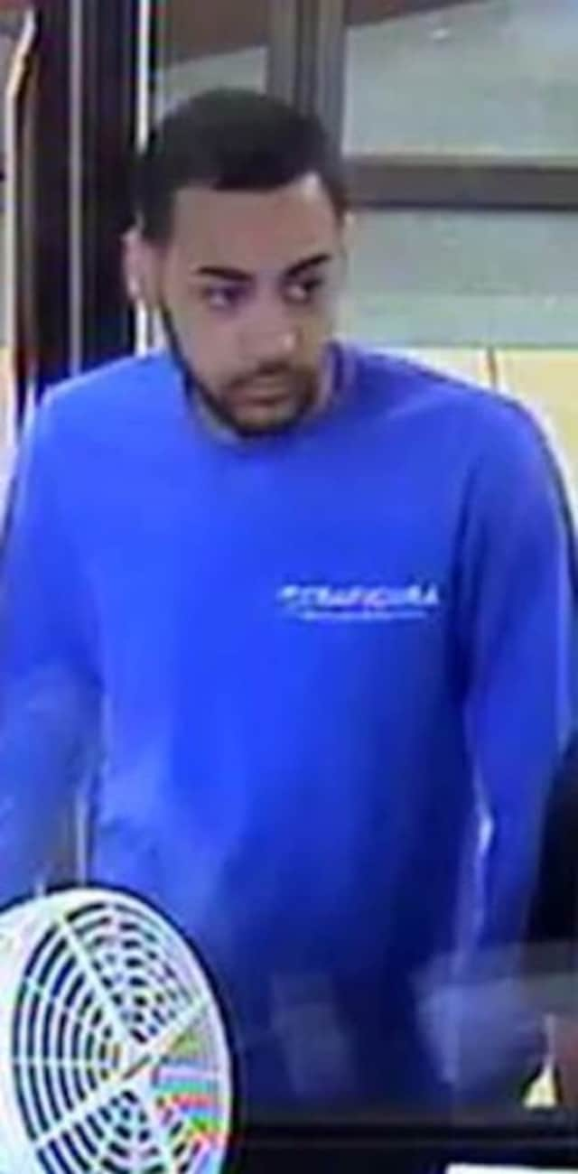 Stamford police are seeking to identify this man, who is suspected of stealing a cellphone from a local Bank of America branch.