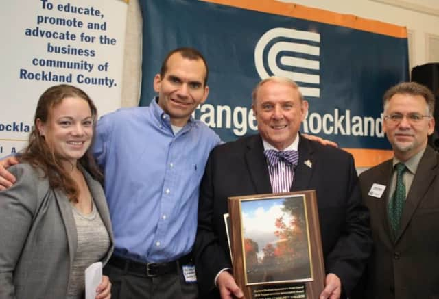 L to R: Cara Politi, 511 Rideshare and Jeff Gerber, Instrumentation Labs with RCC president Dr. Cliff Wood who is accepting award from RBA Green Council chairman Michael Shilale.