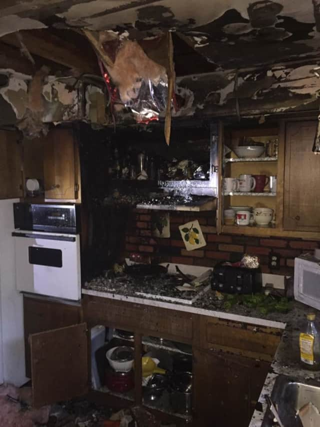 Fire severely damaged a Hillside Lane kitchen on Monday, spreading smoke across the rest of the house.