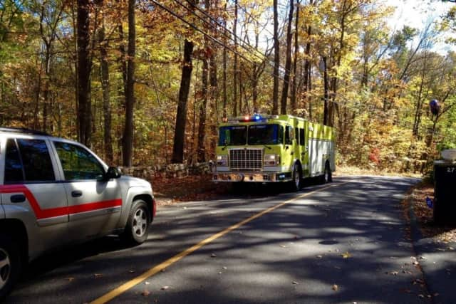 Shortwoods Road in New Fairfield was closed Sunday afternoon due to downed power poles and wires.