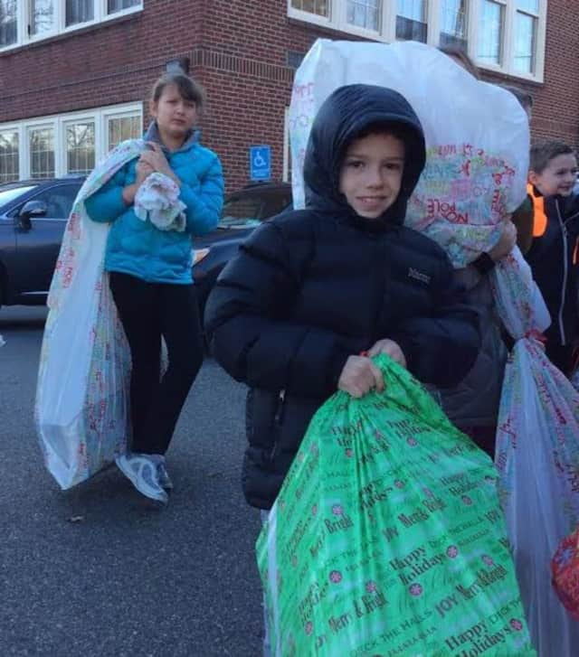 Scarsdale fifth-graders helped deliver toys to kids in the Bronx on Wednesday.