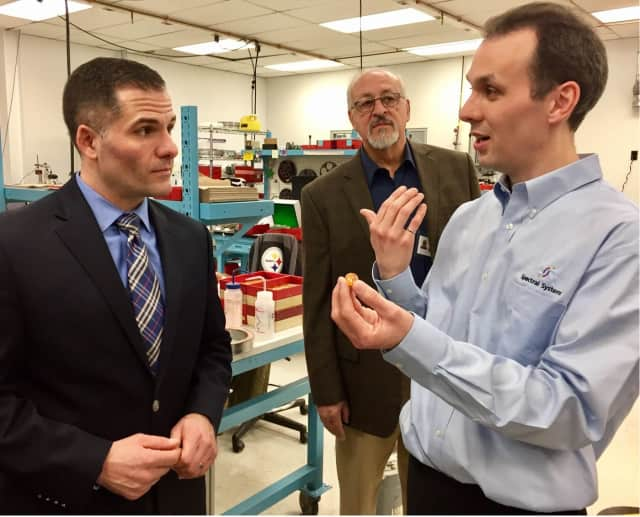County Executive Marc Molinaro (left) and Christopher Harrower, a senior process engineer at Spectral Systems.