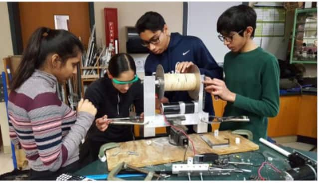 Members of The Ossining O-Bots work on a creation they hope will win them an upcoming tourney in Rockland County and the chance to compete in a worldwide robotics competition this spring.
