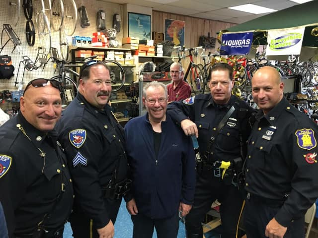 Danny Dentaroli, center, recently celebrated his 50th year in business in Yonkers. The Police Department threw a special party to celebrate.