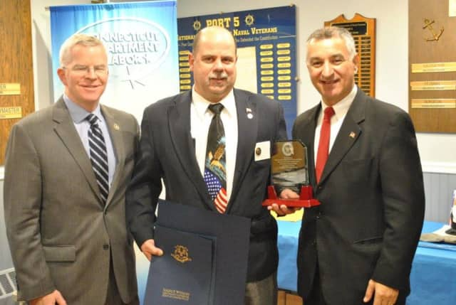 The 2016 awardee, Mike Kellett, center, is flanked by Sean Connolly, commissioner of the CT Department of Veterans' Affairs and state Sen. Carlo Leone.
