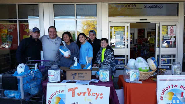 Gullotta House and other local organizations are collecting Thanksgiving turkeys for families in need. Matthew Gullotta, second from left, was joined by volunteers from Sleepy Hollow and Ossining high schools recently at the Stop & Shop on Route 9.