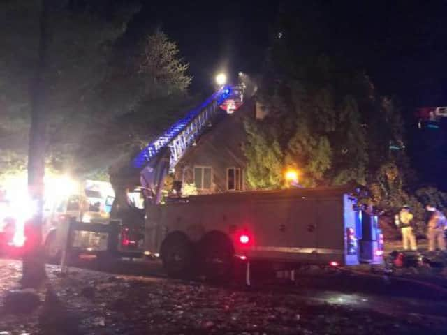 Firefighters battled a large fire at a home on Wesley Chapel Road early Wednesday.