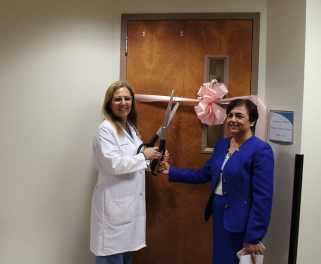 Dr. Lyda Rojas, left, and Dr. Vinita Agarwal cut the ribbon on the new Integrative Health program at Putnam Hospital Center.