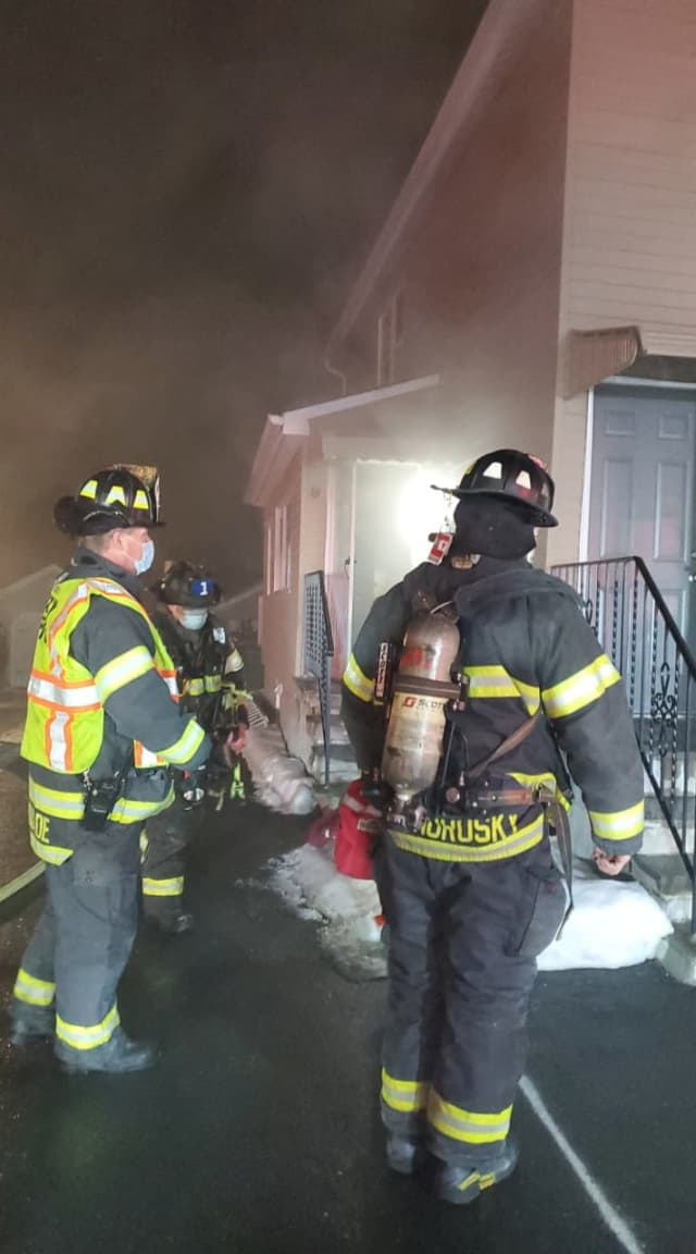 Danbury firefighters work a gas-fed kitchen fire.