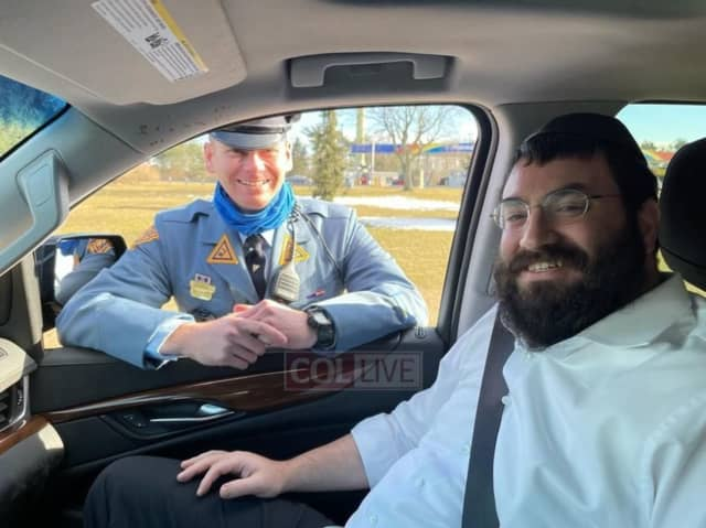 Rabbi Shloime Greenwald and New Jersey State Trooper David Kohn.