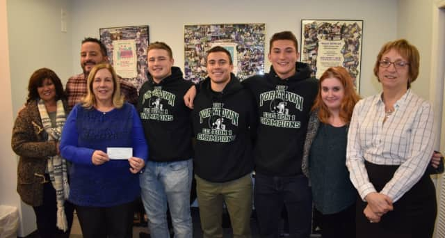 Members of Yorktown High School football team present their donation to Support Connection