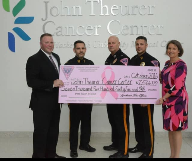 From left: Public Safety Commissioner John Montillo, Captain John Valente, Chief James O'Connor, Sergeant Richard Pizzuti and Nancy Kennedy, Director of Development for the John Theurer Cancer Center.