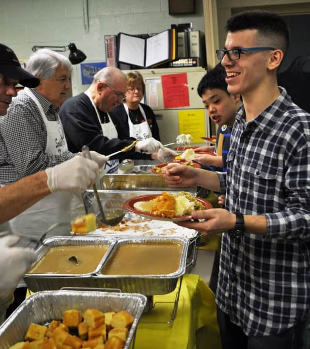 Members of the Saddle Brook Kiwanis Club dish out Thanksgiving meals at the ELCL school in Ho-Ho-Kus last year.
