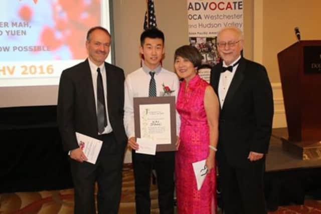 From left: Will Shortz, Kai Zhang, Linda Sledge, Gary Sledge.