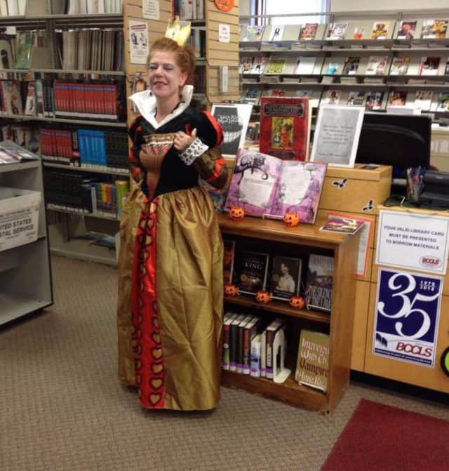 """The Red Queen from """"Alice in Wonderland"""" visits the William E. Dermody Public Library in Carlstadt."""