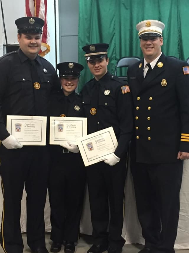 Pictured from left to right: Prob. Firefighter Brendan O'Donoghue, Prob. Firefighter Bridget Foley, Prob. Firefighter Thomas Tooma, Assistant Chief Jon Mackey.