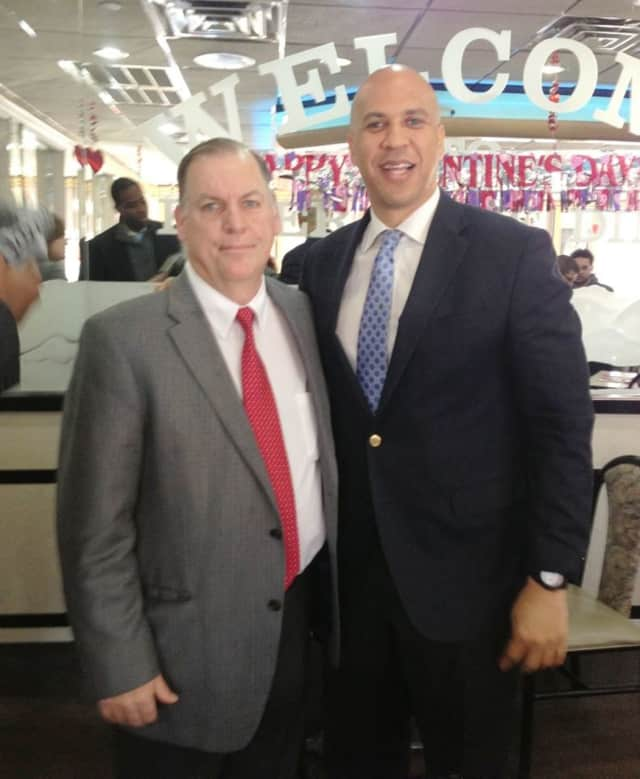 John Fugazzie, left, with United States Senator Corey Booker at the River Edge Diner.