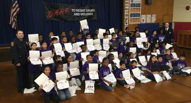 Fifth-grade students from Hempstead Elementary School show off their DARE certificates.