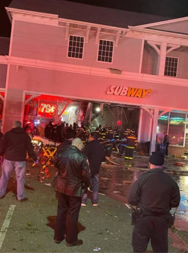 Two vehicles ended up inside a Subway restaurant after a vehicle lost control hit a parked vehicle and caught on fire.