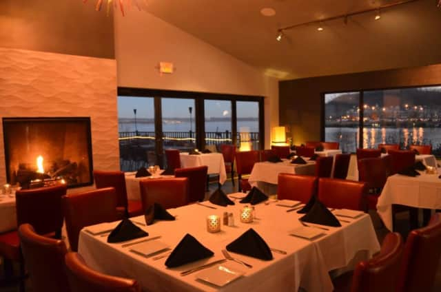 The dining room -- complete with roaring fire -- at Catch on the Hudson in Haverstraw.