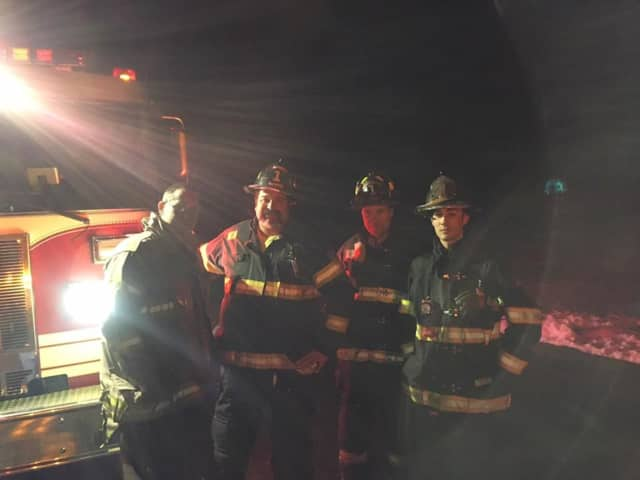 Monroe firefighters pose for a picture after responding to a minor incident on Christmas Eve.