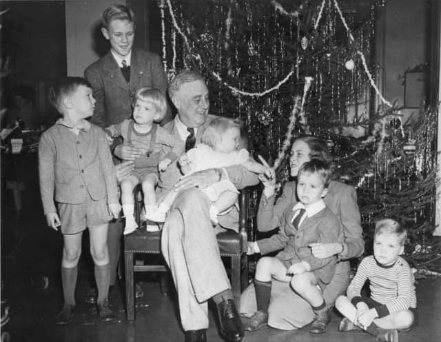 President Roosevelt celebrating Christmas with his grandchildren in the Franklin D. Roosevelt Library Dec. 24, 1943.