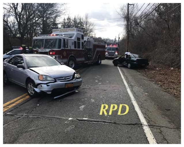 Two people were taken to the hospital with injuries following a two-car crash on Friday in Chestnut Ridge.