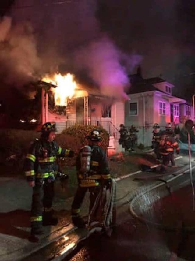 Inwood firefighters battle a house fire on Monroe Avenue.