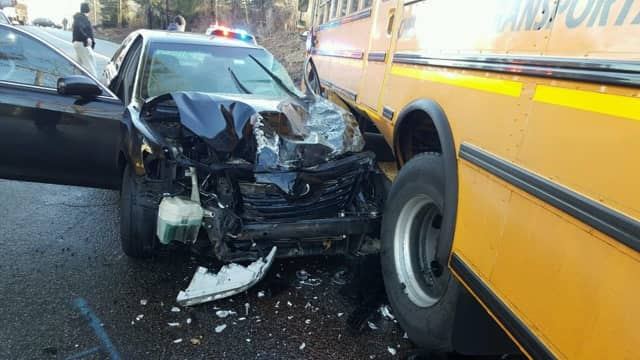 A crash between a taxi and a school bus on Friday sent both drivers to the hospital.