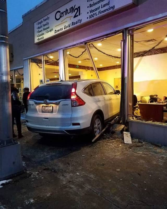 A driver drove his SUV through a Yonkers storefront on Tuesday.