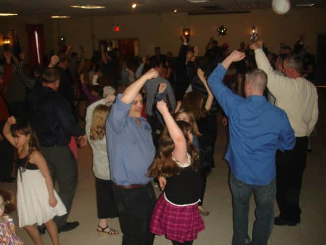 Families dance together at one of the Municipal Drug Alliance's Daddy Daughter Sweetheart Balls in Bloomingdale.