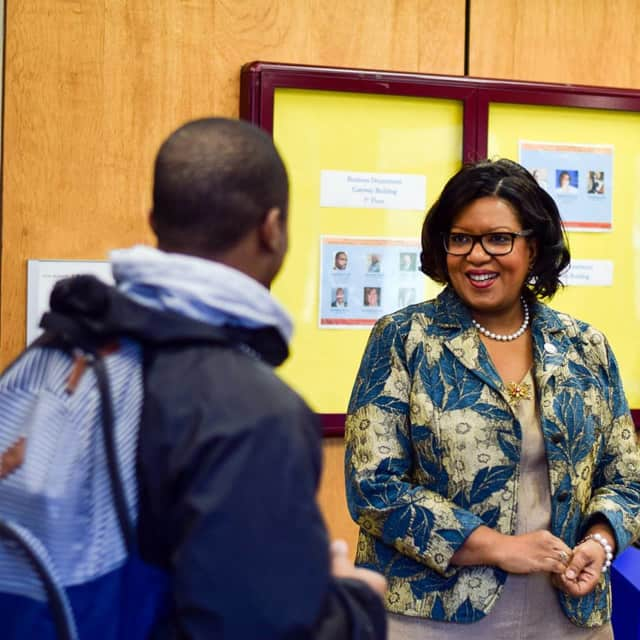 President, Belinda Miles greets a student at Westchester Community College.