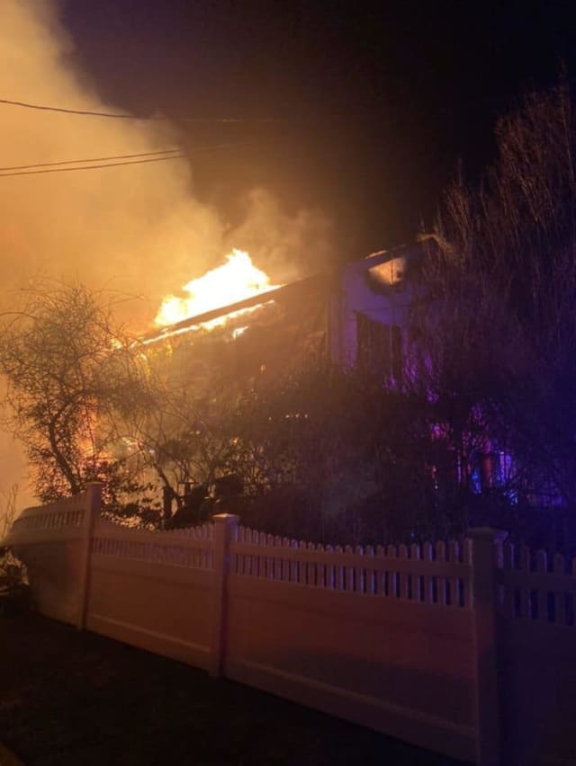 One home was destroyed and four others damaged during an early-morning fire.
