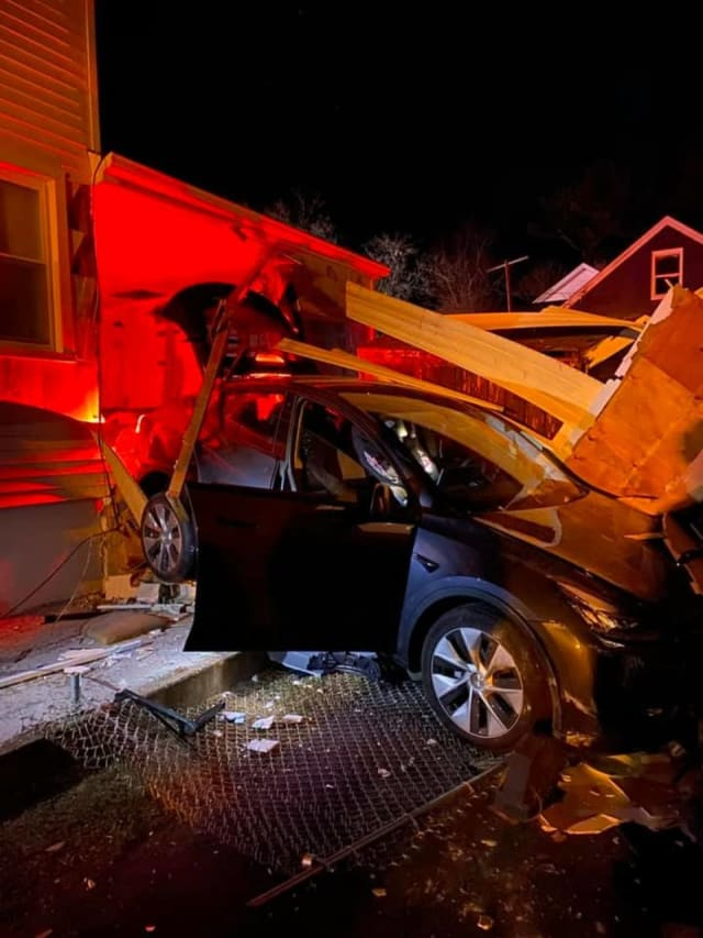 A resident drove through their closed garage door and out the side before hitting a neighboring home.