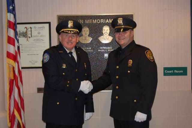 Orangetown Officer Brian Domitrovits (right) was recently promoted to detective with the Youth Division of the department's Detective Bureau.
