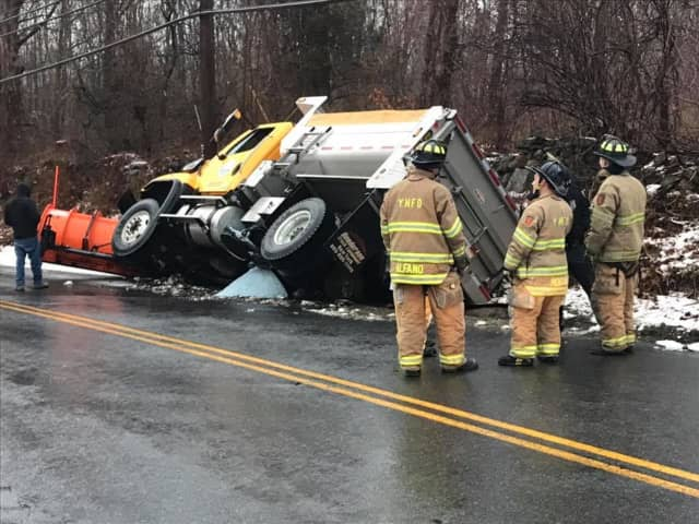 Moseman Road is closed after a salt truck ended up on its side Tuesday.