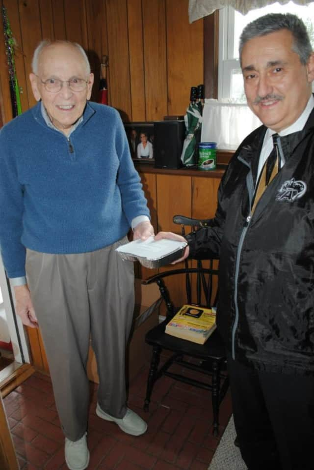 Mayor Tom Giordano delivers a meal to a Waldwick resident.